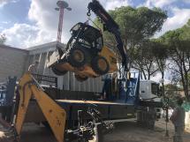 Transporte de maquinaria pesada con nuestro camión grúa