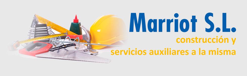 globo terráqueo y grúa, elementos de construcción en Marriot S.L.